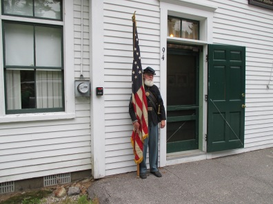 A Civil War soldier stands guard at the schoolhouse before the program begins.